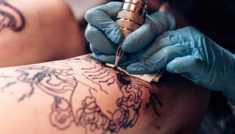 Closeup tattoo artist fill circuit tattooing